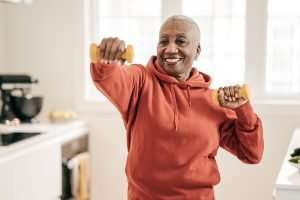 Senior women exercising at home